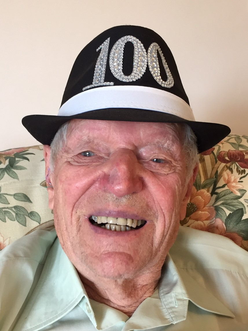 Dennis wearing his 100 years hat